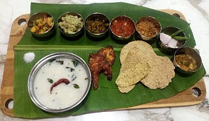 Odisha food comprising of famous water rice, fried vegetables and fish fry