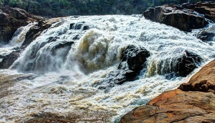 Salunki river in full flow on rocky beds creating one of the top waterfalls of odisha called Putudi falls