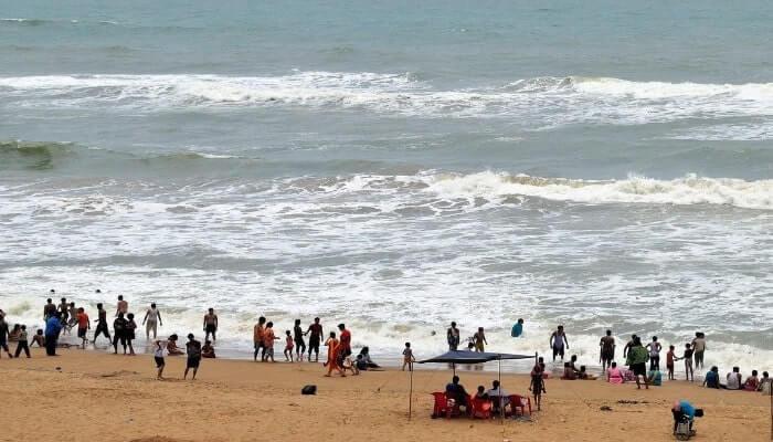 Pleople enjoying on the seashore, one of the best beaches in Odisha