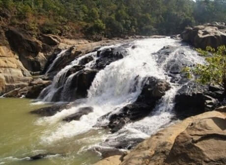 Water flowing over rocky beds creating the beautiful Putudi waterfalls, one of the famous Kandhamal tourist places