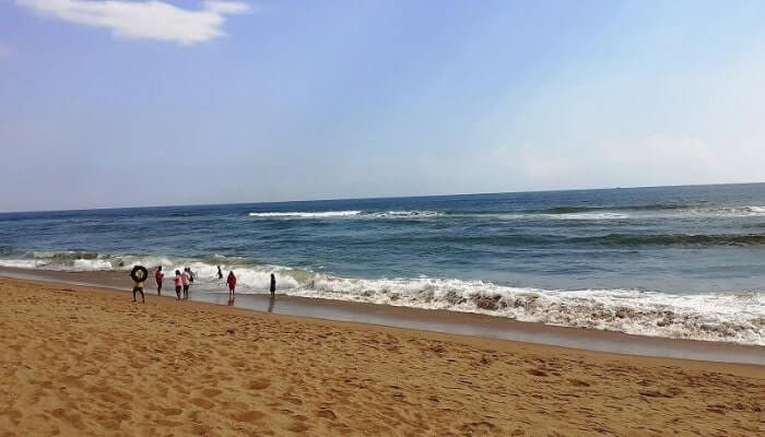 People playing in the waves of Chandrabhaga beach