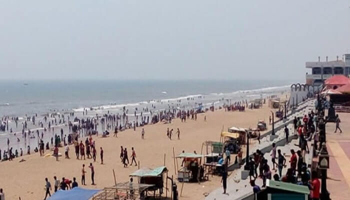 People enjoying the waves at Gopalpur one of the best beaches in Odisha