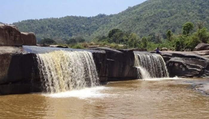 Waterfalling from rock beds creating an enchanting waterfall known as the Khasada waterfall in Gajapati district
