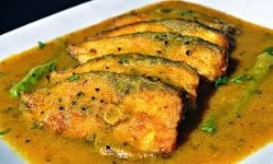 Rohu fish cooked with mustard, red chillies and ginger paste is a a popular dish in Odisha Cuisine