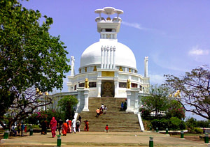 Tourists at the beautiful Shanti Stupa in Dhauli which is one of the top tourist places in Bhubaneswar