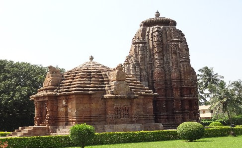 Two towering structures on a raising platform surrounded by lush green garden is famous as Rajarani Temple in Bhubanswar