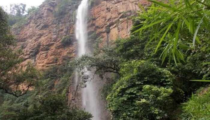 Water falling from high mountain cliff making a beautiful waterfalls famous as Khandadhar Waterfalls