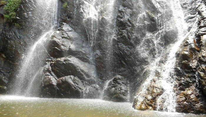Stream of water falling between rocks and creating a pool at the bottom and is in the list of top waterfalls in Odisha