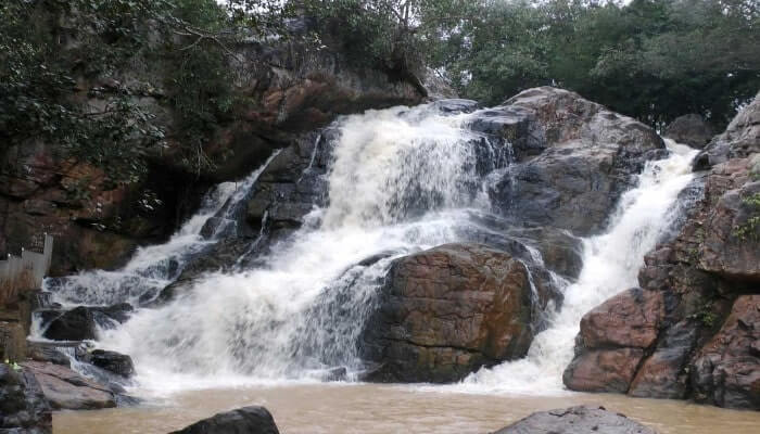 River flowing over rocky beds making a pond at the bottom famous as Sanaghagara Waterfall